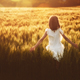 Girl running on cereal field - PhotoDune Item for Sale