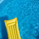 Top view of an inflatable mattress in a backyard swimming pool - PhotoDune Item for Sale