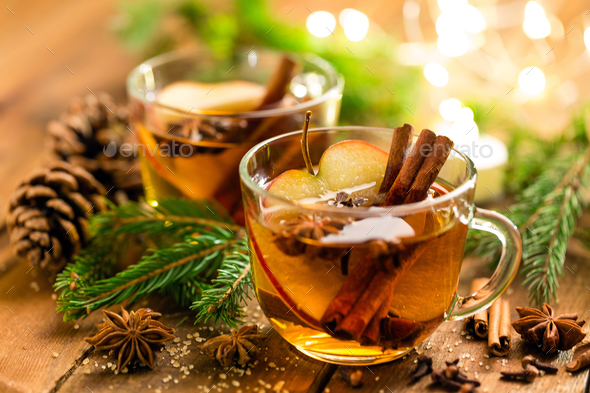 Mulled cider with cinnamon, cloves and anise. Traditional Christmas drink - Stock Photo - Images