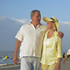 Couple Walking Along The Promenade Holding Hands - VideoHive Item for Sale