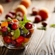 Assorted fruits in glass bowl on kitchen wooden table - PhotoDune Item for Sale