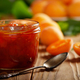 Glass Jar of Apricot jam on wooden table with ripe apricots at b - PhotoDune Item for Sale