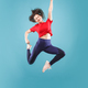 Freedom in moving. Pretty young woman jumping against pink background - PhotoDune Item for Sale