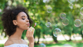 Portrait of young beautiful woman making soap bubbles - PhotoDune Item for Sale