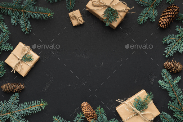 Christmas frame of fir branches and presents - Stock Photo - Images