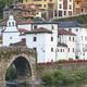 Traditional village in Asturias with stone bridge, Cangas Narcea. Spain - PhotoDune Item for Sale