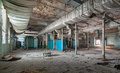 Destroyed production room of an old abandoned textile factory with remains of broken equipment - PhotoDune Item for Sale