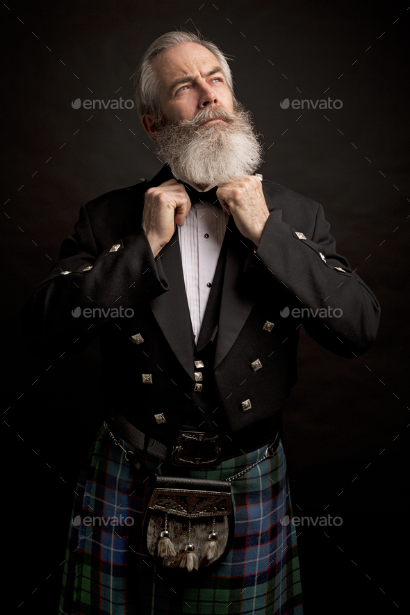 mature male model wearing kilt with grey hairstyle and beard - Stock Photo - Images