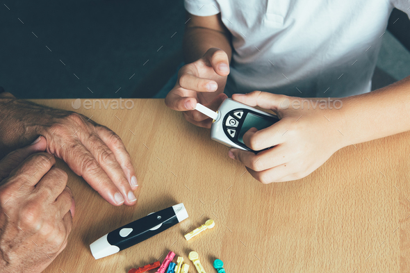 Child hands make a sugar level - Stock Photo - Images