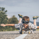 Happy little boy playing on the road at the day time. - PhotoDune Item for Sale