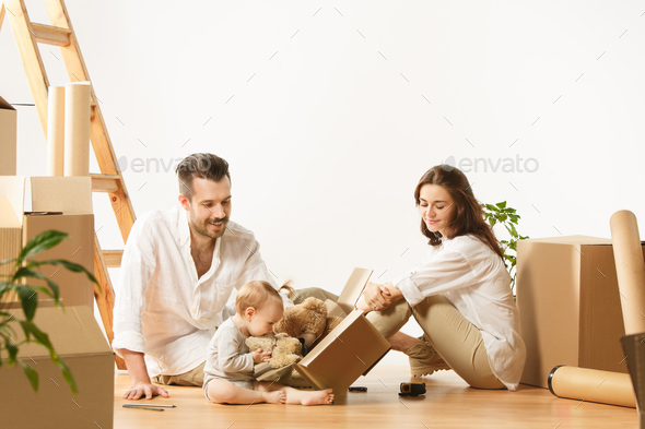 Couple moving to a new home - Happy married people buy a new apartment to start new life together - Stock Photo - Images