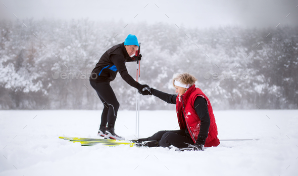 A senior couple cross-country skiing in winter. - Stock Photo - Images