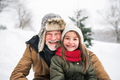 Grandfather and small girl in snow on a winter day. - PhotoDune Item for Sale