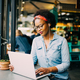 Focused young African woman working online in a cafe - PhotoDune Item for Sale