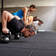 People doing pushups together in a health club class - PhotoDune Item for Sale