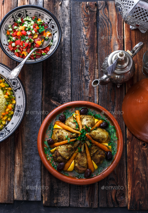 Morrocan family meal tajine, couscous, salad and tea. - Stock Photo - Images