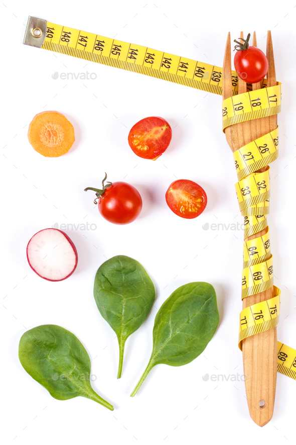 Fork wrapped in centimeter and fresh vegetables, concept of lose weight and healthy nutrition - Stock Photo - Images