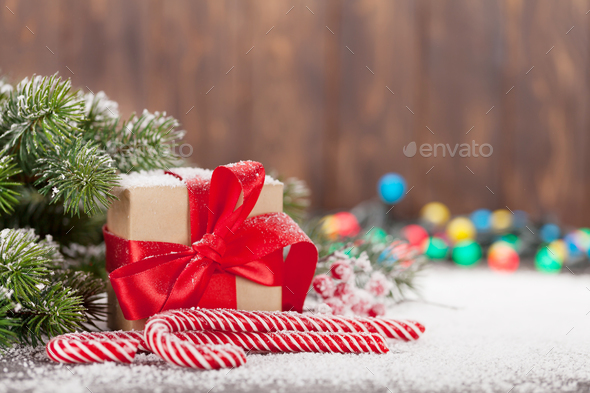 Christmas gift box, candy canes and tree - Stock Photo - Images