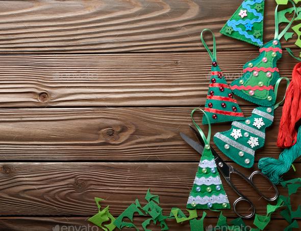 Handmade rustic green felt Christmas tree decorations and scisso - Stock Photo - Images