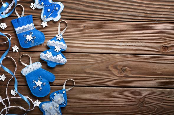 Handmade rustic felt Christmas tree decorations flat laying on w - Stock Photo - Images
