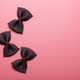 black pasta farfalle on pink background - PhotoDune Item for Sale