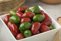 Bowl with red and green Italan Bella olives - PhotoDune Item for Sale