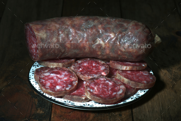 Spanish sausage on rustic board - Stock Photo - Images