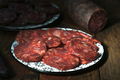 Spanish sausage on rustic board - PhotoDune Item for Sale
