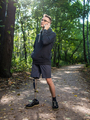 Yong man with prosthetic leg talking on the phone - PhotoDune Item for Sale