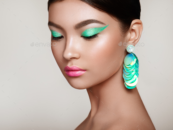 Beautiful Korean Woman with large turquoise earrings - Stock Photo - Images