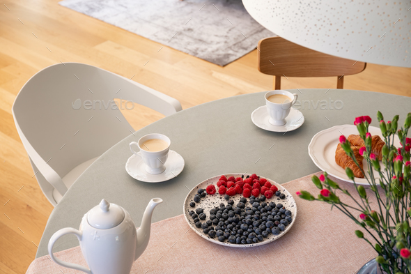 Real photo with high angle of dining table with fresh flowers, j - Stock Photo - Images