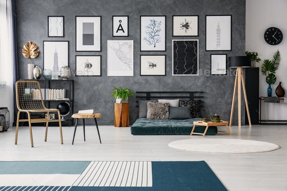 Gold Chair Next To Table And Lamp Green Futon In Grey Ap Stock