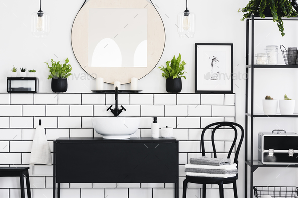 Real photo of black and white bathroom interior with a mirror, c - Stock Photo - Images