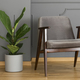 A silver side table and an elegant, upholstered armchair in a mo - PhotoDune Item for Sale