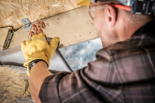 Heating and Cooling Technician - Stock Photo - Images