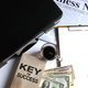 Key of success with notbook , briefcase , dollas and coffee. - PhotoDune Item for Sale