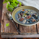 Delicious homemade wild mushrooms soup on rustic wooden backgrou - PhotoDune Item for Sale