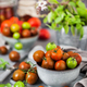 Fresh ripe cherry tomatoes in bowl on gray background - PhotoDune Item for Sale