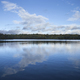 Blue sky and clouds over calm lake at dusk in northern Minnesota - PhotoDune Item for Sale