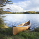 Canoe on the shore of a northern Minnesota lake during autumn - PhotoDune Item for Sale