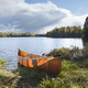 Backlit canoe on shore of northern Minnesota lake during autumn - PhotoDune Item for Sale