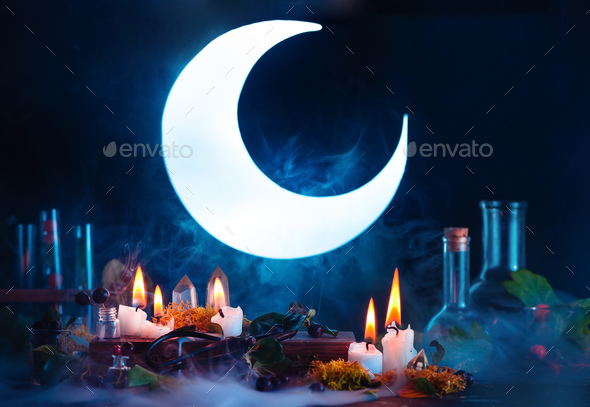 Halloween header with shining full Moon. Witch or wizard workplace with burning candles. Spooky - Stock Photo - Images