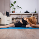 Attactive young woman being flexible during her home training - PhotoDune Item for Sale