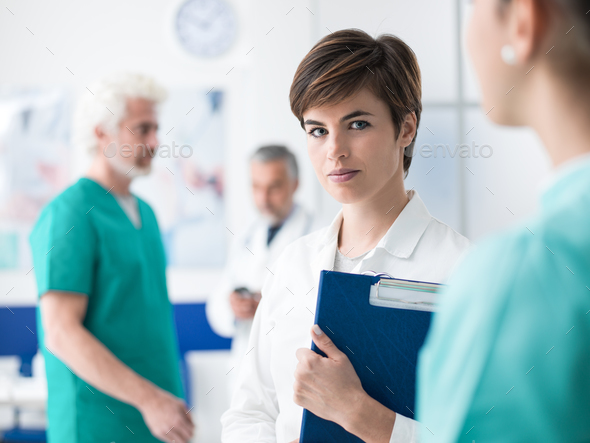 Female doctor working at the clinic - Stock Photo - Images