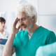 Healthcare worker having an headache - PhotoDune Item for Sale