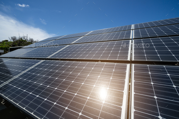 Solar panels against the blue sky with sunlight - Stock Photo - Images