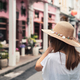 Young woman traveler walking and taking a photo at Phuket old town in Thailand - PhotoDune Item for Sale