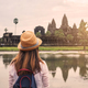 Young woman traveler looking at Angkor Wat, Khmer architecture heritage in Siem Reap, Cambodia - PhotoDune Item for Sale