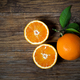 Fresh oranges sliced on old wooden table - PhotoDune Item for Sale