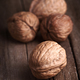 group of nuts on natural wood board - PhotoDune Item for Sale